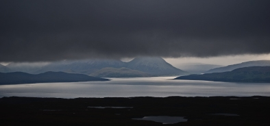 Looking towards Skye from Applecross Pass in the foreground are the small Island's of Scalpay and Raasay