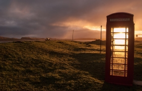 Using an old Post Office Red Telephone Box to filter the sunlight bursting through the cloud after sunrise - the filter generated some really dramatic light - I particularly like the chair drowned in the light drama