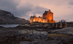 """A castle had stood on this spot since the 13th Century destroyed by the Royal Navy in 1719. Following the failure of the Jacobite rising of 1715, the Jacobites, supporters of the exiled James Stuart, the """"Old Pretender"""", sought new support from Spain. An advance party of 300 Spanish soldiers arrived in Loch Duich in April 1719, and occupied Eilean Donan Castle. The expected uprising of Highlanders did not occur, and the main Spanish invasion force never arrived. At the beginning of May, the Royal Navy sent ships to the area. Early in the morning on Sunday 10 May, HMS Worcester, HMS Flamborough, and HMS Enterprise anchored off Eilean Donan and sent a boat ashore under a flag of truce to negotiate. When the Spanish soldiers in the castle fired at the boat, it was recalled and all three ships opened fire on the castle for an hour or more.[35] The next day the bombardment continued while a landing party was prepared. In the evening under the cover of an intense cannonade, the ships' boats went ashore and captured the castle against little resistance. According to Worcester's log, in the castle they found """"an Irishman, a captain, a Spanish lieutenant, a serjeant, one Scotch rebel and 39 Spanish soldiers, 343 barrels of powder and 52 barrels of musquet shot.""""[36] The naval force spent the next two days demolishing the castle, which took 27 barrels of gunpowder.[37] The Spanish prisoners were put on board Flamborough and taken to Edinburgh.[38] The remaining Spanish troops were defeated on 10 June at the Battle of Glen Shiel. (Wikepedia)"""