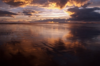 lots of subtle light varied in the way it is has dappled itself unequally across the sky and wet sand - somewhere in Moray - well you cant have all the details or you will be on my doorstep pinching my great sky's
