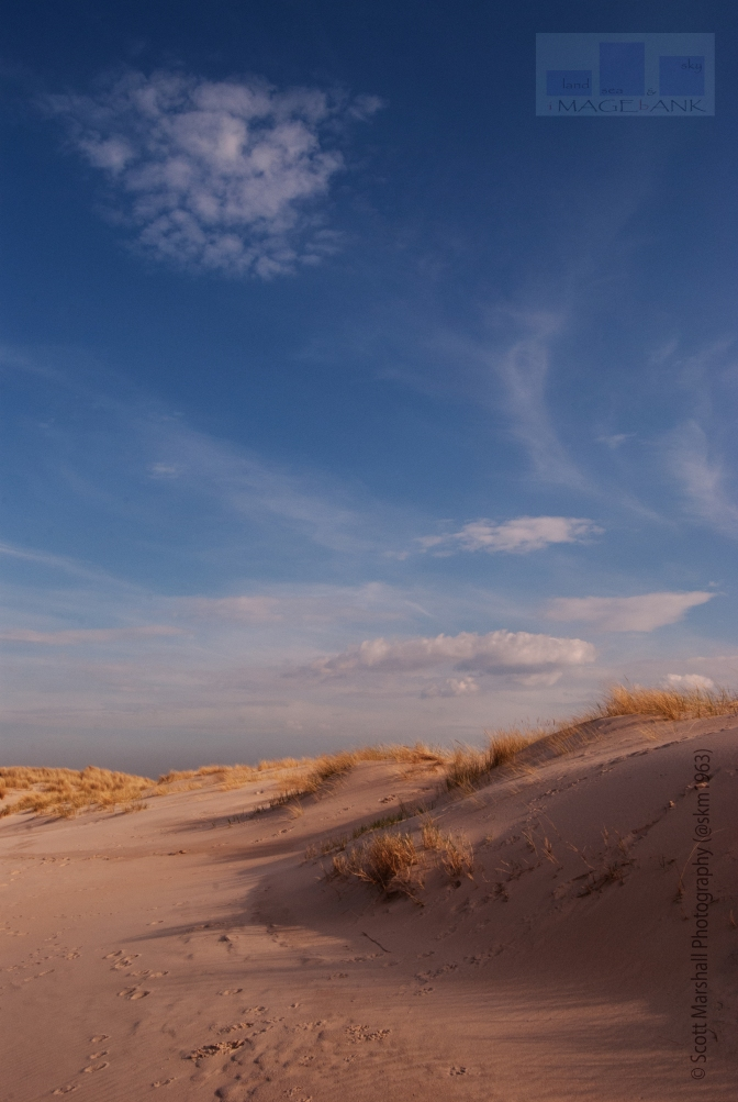 So what have we here? Some sand dunes - a bit of light n shade and a little puffy cloud - I wanted to post something bright and cheerful - equally I wanted to post something which wouldn't be seen as one of my safe standard shots
