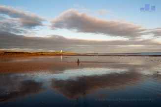 An exceptional morning on Lossiemouth West Beach, Covesea Lighthouse has just succumbed to the first light of the day. The tide is full out offering a glass surface reflection.