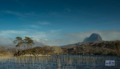 This is rapidly becoming one of my favourite mountains and I have only seen it from about 8 miles out. That said I have seen it from every side and in most weather conditions. I do think framing it from the Loch with the small tree island places it in a truly grand setting. Oh by the way I did say mountain but technically it is only a Corbet but with such a dramatic shark fin shape and steep slopes it deserves real consideration - enjoy.