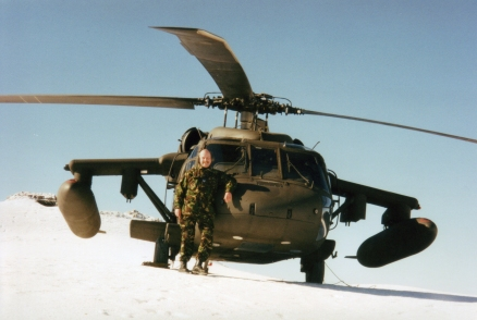 Posing in front of a US Blackhawk perched on top of a Bosnian Mountain