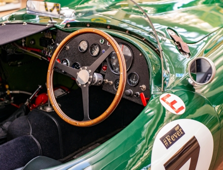Classic Racing Car Cockpit showing the steering wheel and instrument details.